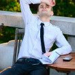Hard day at work - Tired business man relaxing with hands on the head — Stock Photo