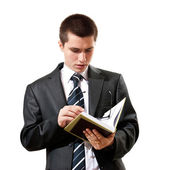 Young man in a suit reading a book — Stock Photo
