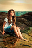 Young woman on rocks — Stock Photo