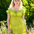 Portrait of blond woman in green dress outdoor — Stock Photo