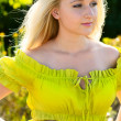 Portrait of blond woman in green dress outdoor — Stock Photo #11977079