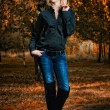 Full length, walking woman in autumn park — Stock Photo