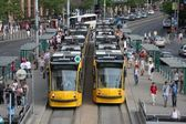 The busiest tram line in Budapest, with 2 Siemens Combino trams in the stops and lot of passangers on the platforms. — Stock Photo