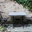Desk and chairs in the garden — Stock Photo