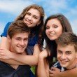 Happy teen friends outdoors — Stock Photo #11482798