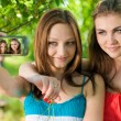 Royalty-Free Stock Photo: Two young girls taking picture of themselves