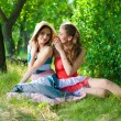 Two happy teenage girls chatting outdoors — Stock Photo