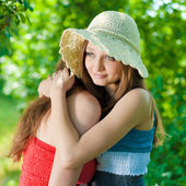 Young girl comforting her friend — Stock Photo