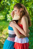 Young girl comforting her friend — Stockfoto