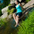 Young happy beautiful woman sitting by the river — Stock Photo #12292073