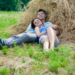 Young happy couple resting outdoors - Stock Photo