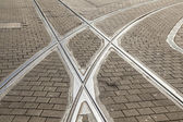 Rails of streetcar in old cobble stone street — Stock Photo
