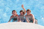Cute boys have fun in the pool — Foto Stock