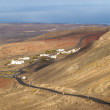 Winding road along an old volcano to Femes, Lanzarote — Foto Stock