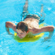Stock Photo: Boy surfing in the pool