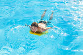 Boy surfing in the pool — Stock Photo