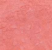 Red concrete wall with rough pattern — Stock Photo