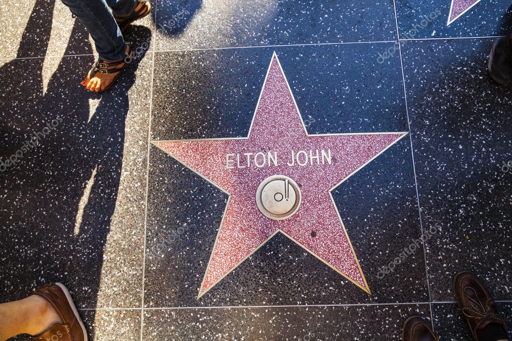 HOLLYWOOD - JUNE 26: Elton John's star on Hollywood Walk of Fame on June 26, 2012 in Hollywood, California. This star is located on Hollywood Blvd. and is one of 2400 celebrity stars. — Stock Photo #11530508