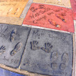 Matt Demon and Will Smiths handprints in Hollywood Boulevard - Stock Photo