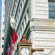 Facade with old clock in the gaslamp quarter in San Diego - Stock Photo