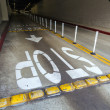 Stop sign in a garage painted on the asphalt — Stockfoto