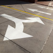 Stock Photo: Arrows and lines on asphalt to indicate direction of dri