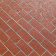 Pattern of harmonic red tiles at floor — Stock Photo #11794199