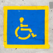 Handicapped symbol on parking space — Stock Photo #11816540