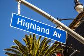 Street sign Highland Av in Hollywood — Stock Photo