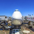 LufthansBoeing 747 parks at gate position — Stock Photo #12023816