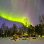 Northern Lights (Aurora borealis) over snowscape. — Stock Photo