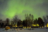 Northern Lights (Aurora borealis) over snowscape. — Stock Photo