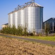 Field in harvest with silo — Stock Photo