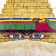 Bodhnath stupa in kathmandu with buddha eyes and prayer flags wi - Stock Photo