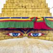 Bodhnath stupa in kathmandu with buddha eyes and prayer flags wi — Stock Photo
