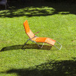 Empty sun lounger in the garden — Stock Photo