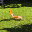 Empty sun lounger in the garden — Stok fotoğraf