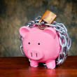 Chained piggybank — Stock Photo