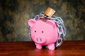 Chained piggybank — Stock Photo