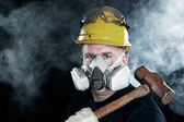 Worker in smoke — Stock Photo