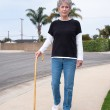 Woman walking with cane — Stock Photo #11332448