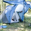 Tent on grass in the forest — Stock Photo