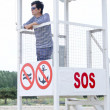 Beach lifeguard tower with stuff person — Stock Photo