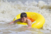 The child is bathed in a sea of yellow rubber circle — Stock Photo