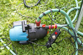 Garden hose and water pump connection — Stock Photo