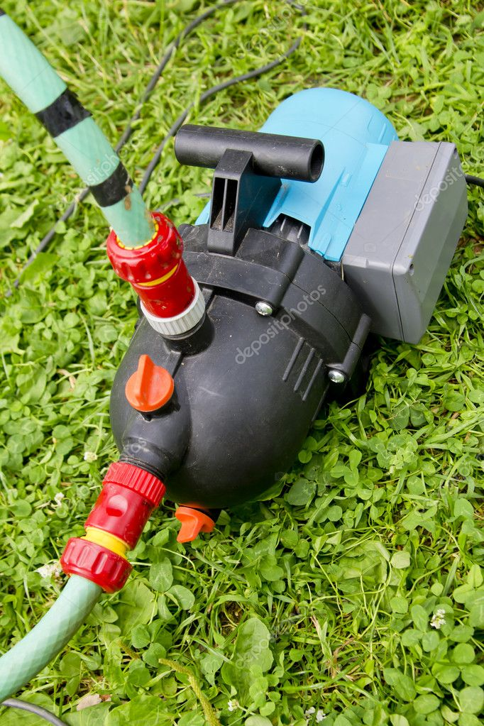 Garden hose and water pump connection stock photo for Garden pond hose