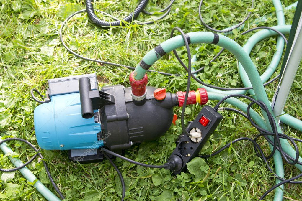 Garden hose and water pump connection Stock Photo kaparulin