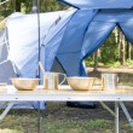 Tourist utensils near camping tent — Stock Photo #11817007