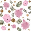 Stock Photo: Piggy Banks and American Money Flying over White