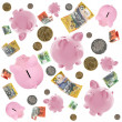 Piggy Banks and Australian Money Falling over White — Foto de Stock